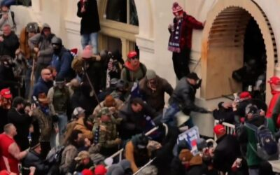 Democrats begin impeachment trial with stunning riot video